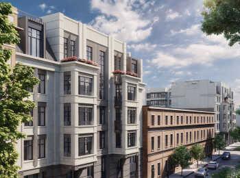 Штукатурные фасады выполнены в светло-серой гамме